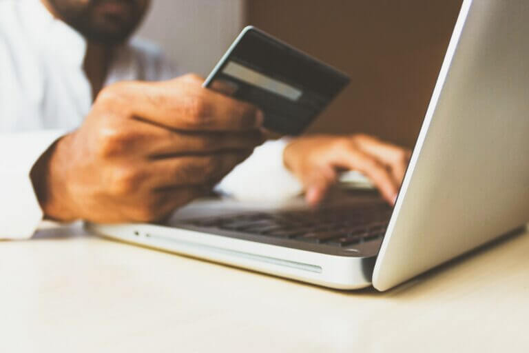 Hands of Person Completing a Purchase on Computer